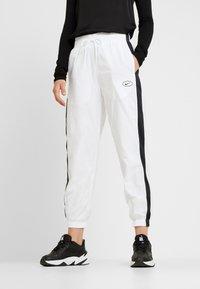 Nike Sportswear - Tracksuit bottoms - white - 0