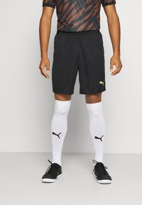 Puma - FTBLNXT SHORTS - Sports shorts - black/nrgy peach/fizzy yellow - 0