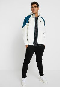 Nike Sportswear - Summer jacket - light cream/nightshade