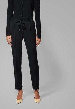 TARIYANA9 - Trousers - black