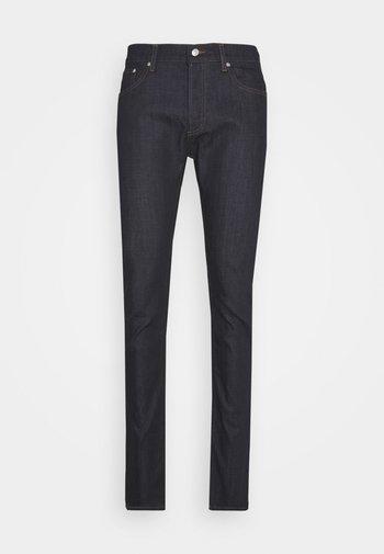 SKINNY RAW - Slim fit jeans - denim