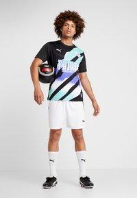 Puma - RETRO  - Print T-shirt - black - 1