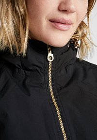 Regatta - BERGONIA - Winter jacket - black/gold - 3