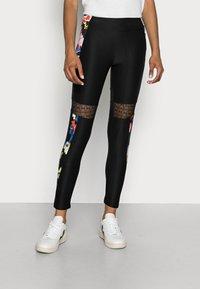 Desigual - CALIX BY CHRISTIAN LAXROIE - Leggings - Trousers - black - 0