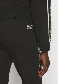 EA7 Emporio Armani - Pantalones deportivos - black/white - 4