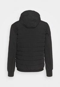 Calvin Klein - QUILTED MIX ZIP HOODIE - Light jacket - black - 1