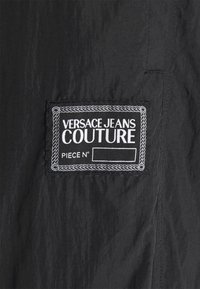 Versace Jeans Couture - CRINKLE  - Tracksuit bottoms - black - 7