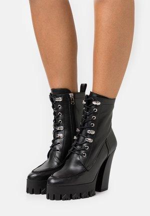 STIVALI BOOTS - Šněrovací kotníkové boty - nero
