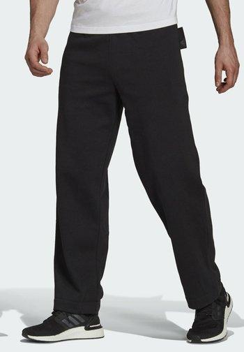 M FI CC FL PANT - Pantaloni sportivi - black