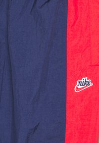 Nike Sportswear - Tracksuit bottoms - midnight navy/university red/white - 2