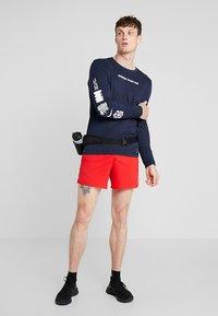 Nike Performance - DRY RUN SEASONAL  - Camiseta de deporte - obsidian/white - 1
