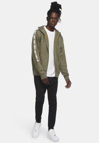 Nike Sportswear - REPEAT HOODIE - Zip-up hoodie - medium olive/white - 1