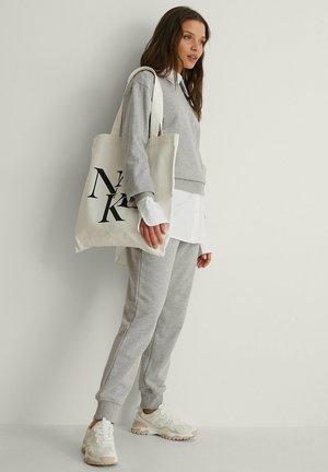 LAYERED LOGO - Tote bag - natural