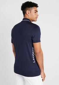 Lacoste Sport - Funktionströja - navy blue/onagre white - 2