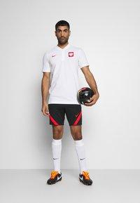 Nike Performance - POLEN MODERN  - Print T-shirt - white/sport red - 1