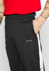 Nike Sportswear - Spodnie treningowe - black/white - 5