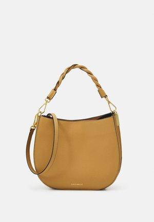 ARPEGE - Handbag - warm beige/noir