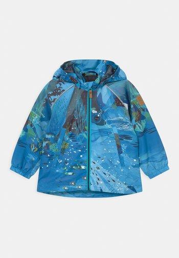 HETE UNISEX - Waterproof jacket - aquatic