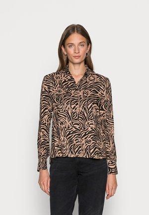 WINTER - Button-down blouse - soft camel / black zebra