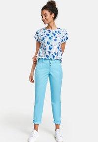 Taifun - Trousers - turquoise - 1