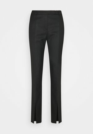HERLENE - Trousers - black