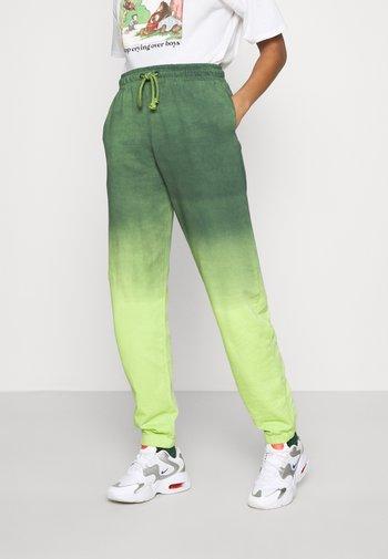 CUFFED - Pantalones deportivos - multi