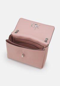 Calvin Klein - RELOCK FLAP XBODY - Handbag - blush - 2
