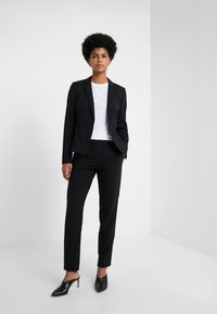 HUGO - Trousers - black - 1