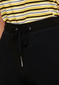 Topshop - MONO JEGGER - Leggings - Trousers - plain black - 4