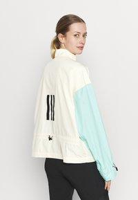 adidas Performance - Back-to-School W.R ANORK URBAN WIND.RDY OUTDOOR RELAXED JACKET - Windbreaker - cream white/clear mint - 2