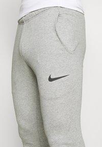 Nike Performance - PANT TAPER - Tracksuit bottoms - dark grey heather/black - 5