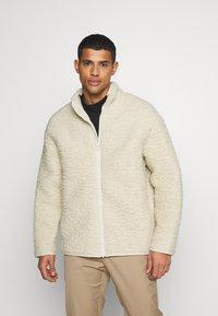 Weekday - CHEN PILE JACKET UNISEX - Winter jacket - beige - 0
