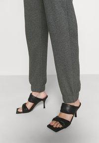 ONLY - ONLNELLA PANTS - Tracksuit bottoms - dark grey melange - 3