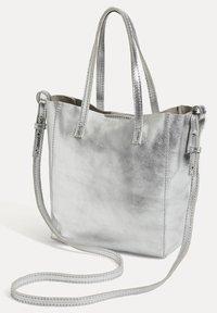 OYSHO - METALLIC LEATHER MINI SHOPPER - Handbag - silver - 2
