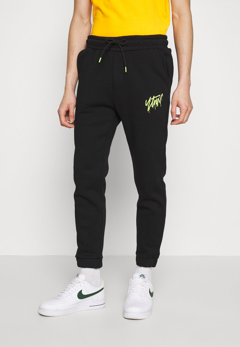 YOURTURN - Tracksuit bottoms - black