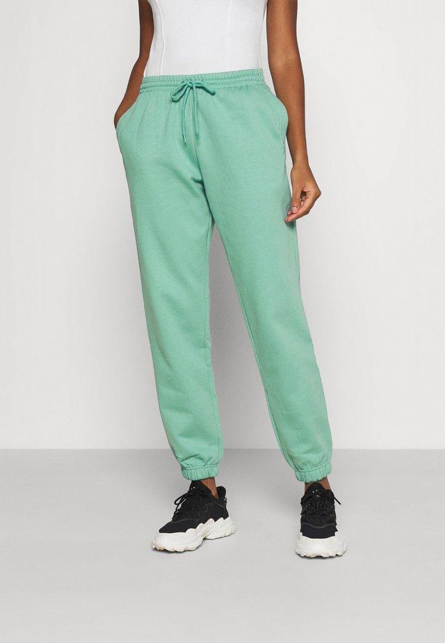 TIN - Spodnie treningowe - green