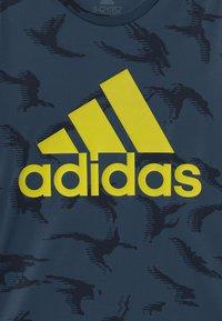adidas Performance - UNISEX - Print T-shirt - crew navy/solar yellow - 2