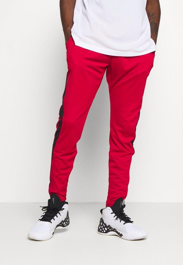 AIR DRY PANT - Teplákové kalhoty - gym red/black