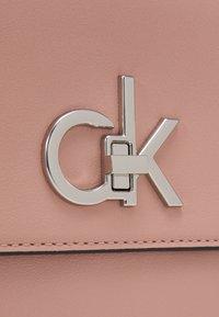 Calvin Klein - RELOCK FLAP XBODY - Handbag - blush - 4