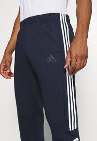 adidas Performance - ESSENTIALS TRAINING SPORTS PANTS - Tracksuit bottoms - LEGINK/WHITE - 3