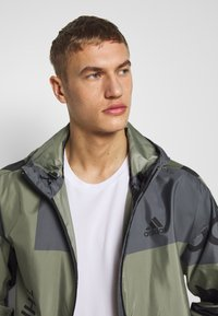adidas Performance - URBAN ALLOVER PRINT WIND.RDY  - Outdoor jacket - green - 3