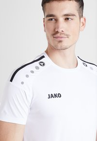 JAKO - TRIKOT STRIKER  - Sports shirt - weiß/schwarz - 4