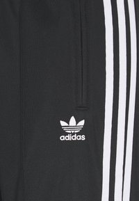adidas Originals - FIREBIRD - Tracksuit bottoms - black - 5