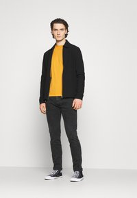 Replay - ANBASS HYPERFLEX REUSED - Slim fit jeans - dark grey - 1