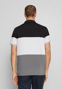 Puma Golf - TAYLOR - Polo shirt - black - 2