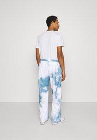 Jaded London - CLOUD - Tracksuit bottoms - blue/white - 2