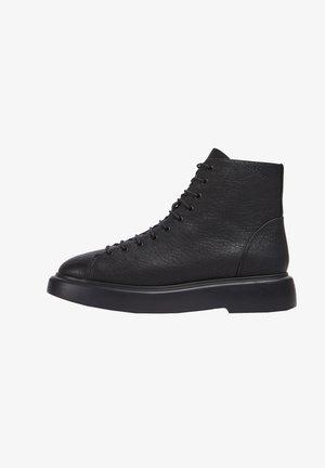 POLIGONO T - Lace-up ankle boots - schwarz