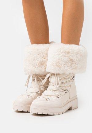 LARYA - Lace-up boots - cream