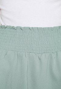 ONLY - ONLNOVA LUX SMOCK  - Plisovaná sukně - chinois green - 5