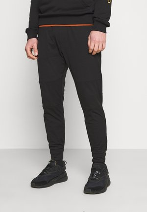 JOGGER  INVISIBLE ZIPPERS - Tracksuit bottoms - black